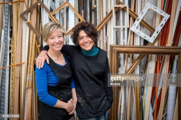 Restorer and framer laboratory craftswomen: owners posing
