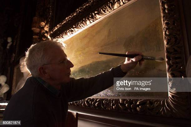 Restorer Graeme Dowling puts the finishing touches to a reproduction of a 19th century Ritson carving framing a Turner painting at the National...