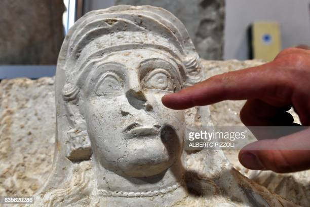 A restorer points the missing noise of a woman bust which is one of the two funeral reliefs from Palmyra archeological site that will be restored at...