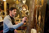 restorer working in his beautiful studio
