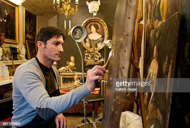 restorer working in his beautiful studio