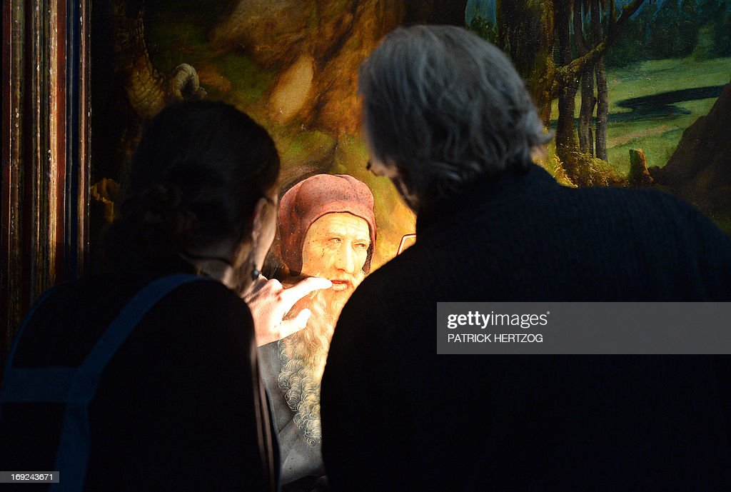 Restorers inspect the 'Isenheim Altarpiece' ('retable d'Issenheim' in French) by German Renaissance painter Matthias Grunewald, at the chapel of the Unterlinden museum in the eastern French city of Colmar, on May 22, 2013. A research team are studying if the 500-year old famed Renaissance religious work can be restored.