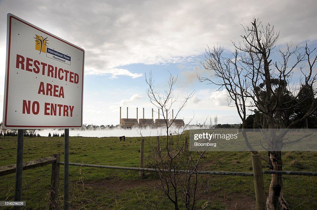 A restricted entry sign stands in front of International Power Plc's Hazelwood coal-fired power station as steam rises from the property's cooling pond in the Latrobe Valley, Australia, on Wednesday, Sept. 7, 2011. Australian prime minister Julia Gillard's plan to make factories and utilities either cut the nation's greenhouse gases or pay for pollution-curbing programs abroad may force companies to buy an average 66 million metric tons of credits a year starting in 2015, sending prices up 28 percent. Photographer: Carla Gottgens/Bloomberg via Getty Images