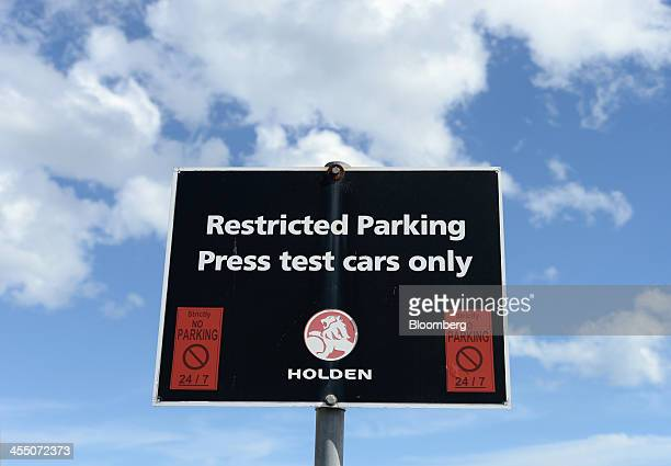 A 'restricted parking' sign stands in a parking lot at the GM Holden Ltd headquarters in Melbourne Australia on Wednesday Dec 11 2013 General Motors...