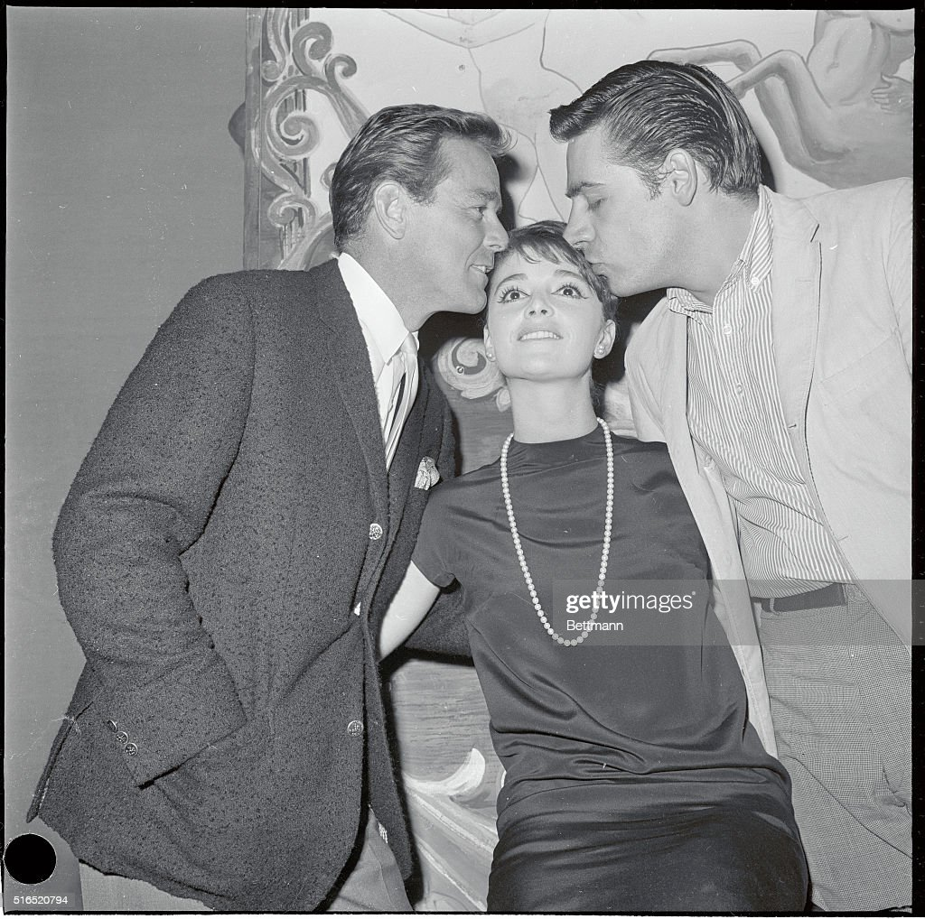 Resumes her star role. Producer Gower Champion (left) and leading man Jerry Orbach affectionately welcome singer Anna Maria Alberghetti back to the cast of Carnival at Imperial Theatre. Ann Maria praised understudy Anita Gillette who superbly filled the role during Miss Alberghetti's hospitalization. A bit on the sour side, the singing star took issue with producer David Merrick (with whom she's been feuding), charging that he quoted her show salary at less that half of 'what it actually is.'