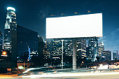 Side view of blank white billboard in nighttime city. Retail concept. Mock up, 3D Rendering