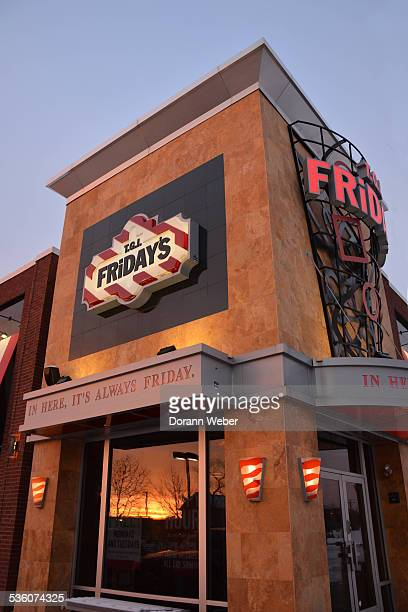 Retail Store logo and sign TGIF Fridays restaurant Hamilton New Jersey during sunset