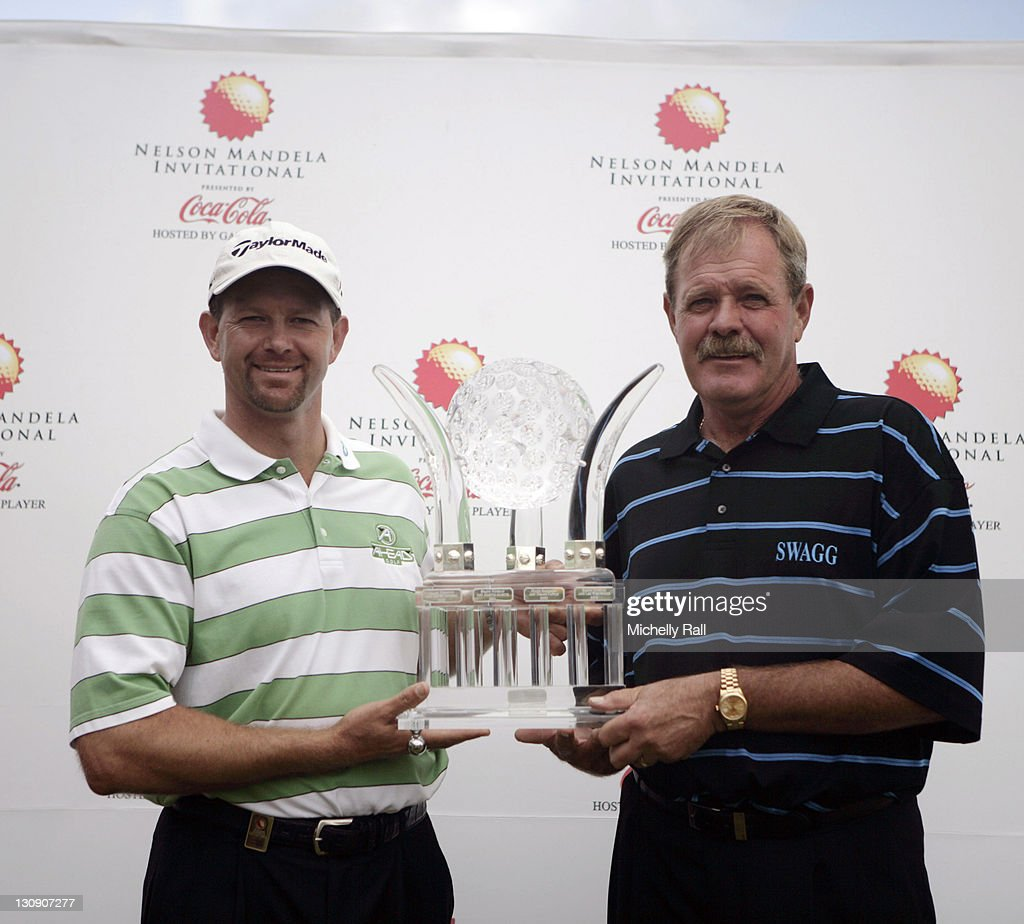 <a gi-track='captionPersonalityLinkClicked' href=/galleries/search?phrase=Retief+Goosen&family=editorial&specificpeople=201918 ng-click='$event.stopPropagation()'>Retief Goosen</a> and Bobby Lincoln celebrate with the trophy at Arabella Country Estate in South Africa on November 26, 2006.