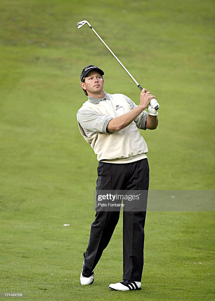 <a gi-track='captionPersonalityLinkClicked' href=/galleries/search?phrase=Retief+Goosen&family=editorial&specificpeople=201918 ng-click='$event.stopPropagation()'>Retief Goosen</a> competes during the first round of the HSBC World Matchplay Championship held at Wentworth Golf Club's West Course. October 14, 2004.