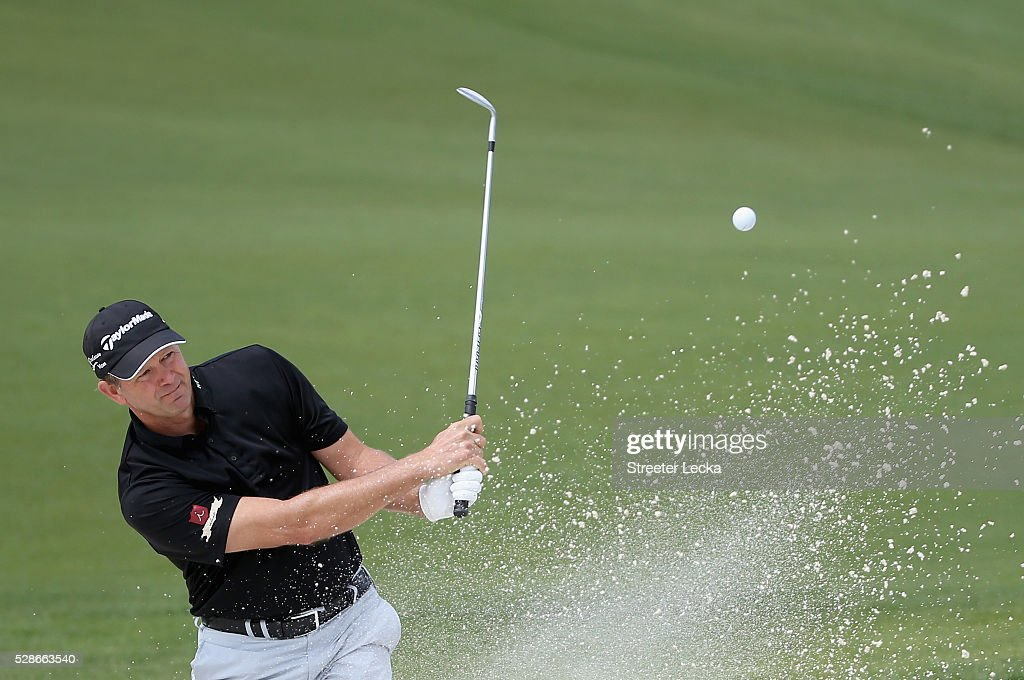 Retief Goosen hits a shot from the sand on the 16th hole during the second round of the 2016 Wells Fargo Championship at Quail Hollow Club on May 6, 2016 in Charlotte, North Carolina.