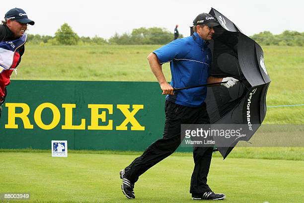 Retief Goosen of South Africa battles the wind during the Pro Am of The European Open at the London Golf Club on May 27 2009 in Ash England