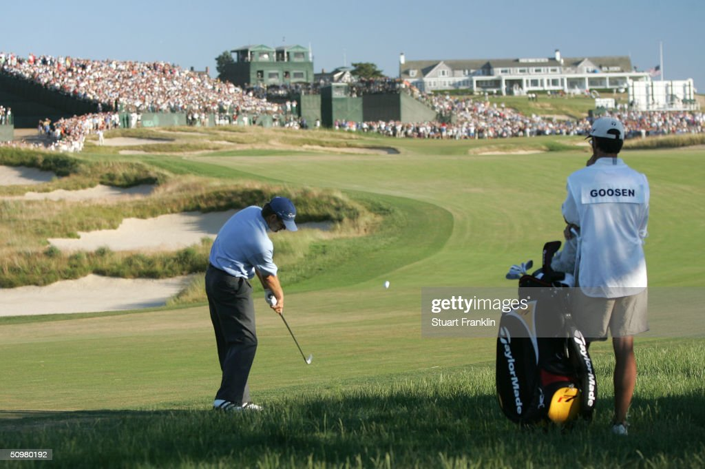 Retief Goosen of South Africa hits his second shot on the 16th hole during the 104th US Open at Shinnecock Hills Golf Club on June 20 2004 in...