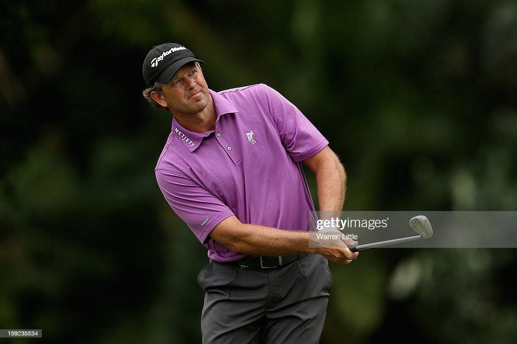 <a gi-track='captionPersonalityLinkClicked' href=/galleries/search?phrase=Retief+Goosen&family=editorial&specificpeople=201918 ng-click='$event.stopPropagation()'>Retief Goosen</a> of South Africa in action during the first round of the Volvo Golf Champions at Durban Country Club on January 10, 2013 in Durban, South Africa.