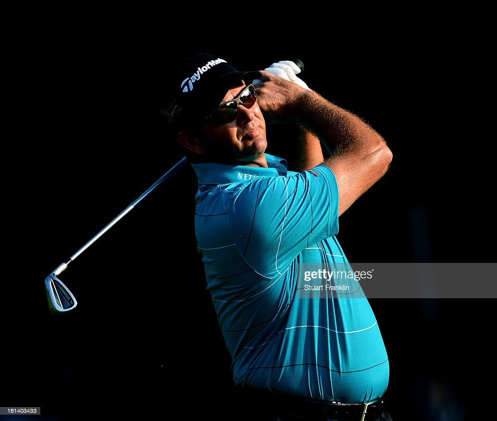 <a gi-track='captionPersonalityLinkClicked' href=/galleries/search?phrase=Retief+Goosen&family=editorial&specificpeople=201918 ng-click='$event.stopPropagation()'>Retief Goosen</a> of South Africa plays a shot during the third round of the Italian Open golf at Circolo Golf Torino on September 21, 2013 in Turin, Italy.