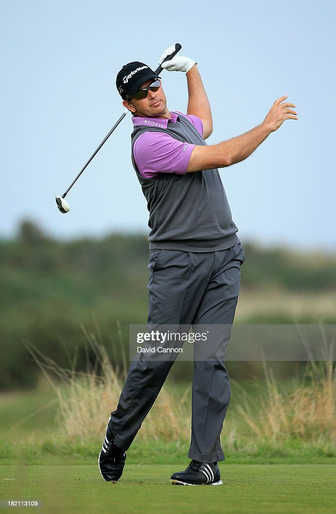 <a gi-track='captionPersonalityLinkClicked' href=/galleries/search?phrase=Retief+Goosen&family=editorial&specificpeople=201918 ng-click='$event.stopPropagation()'>Retief Goosen</a> of South Africa plays off the nineth tee during the third round of the Alfred Dunhill Links Championship on The Old Course, at St Andrews on September 28, 2013 in St Andrews, Scotland.
