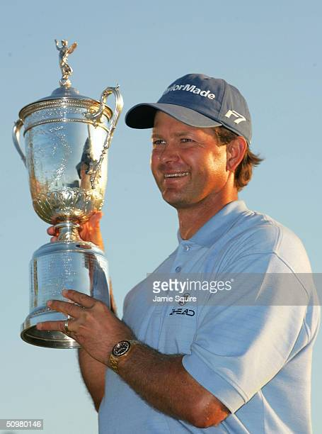 Retief Goosen of South Africa poses with the trophy after a twostroke victory at the 104th US Open at Shinnecock Hills Golf Club on June 20 2004 in...