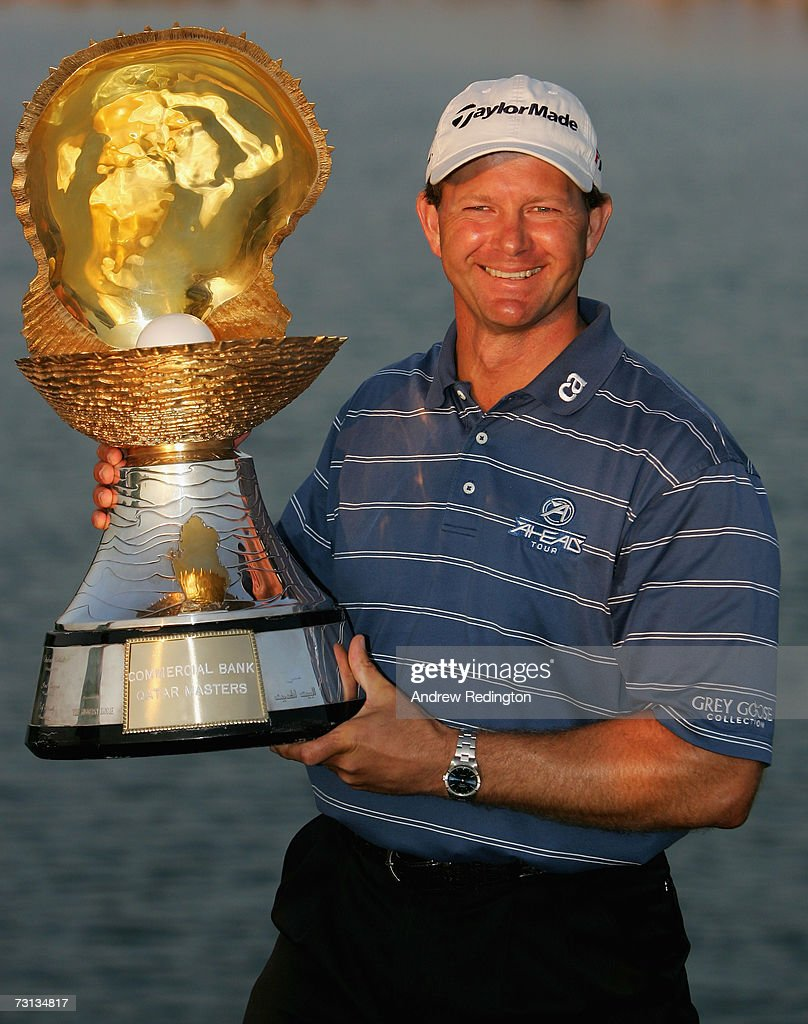 Retief Goosen of South Africa poses with the trophy after winning The Commercial Bank Qatar Masters at Doha Golf Club on January 28 2007 in Doha Qatar