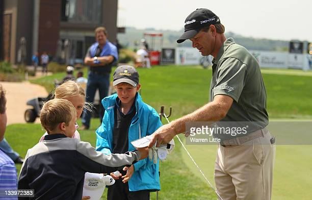 Retief Goosen of South Africa signs autographs for the kids during the ProAm event ahead of the South African Open Championship at Serengeti Golf...