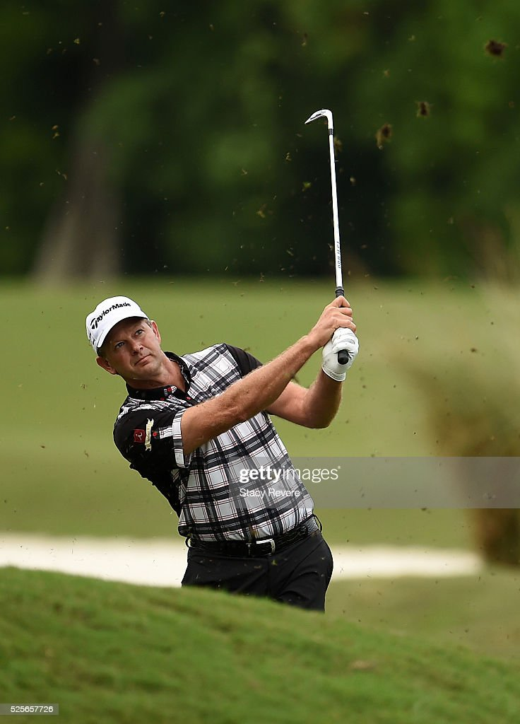 Retief Goosen of South Africa takes his second shot on the 16th hole during the first round of the Zurich Classic of New Orleans at TPC Louisiana on April 28, 2016 in Avondale, Louisiana.