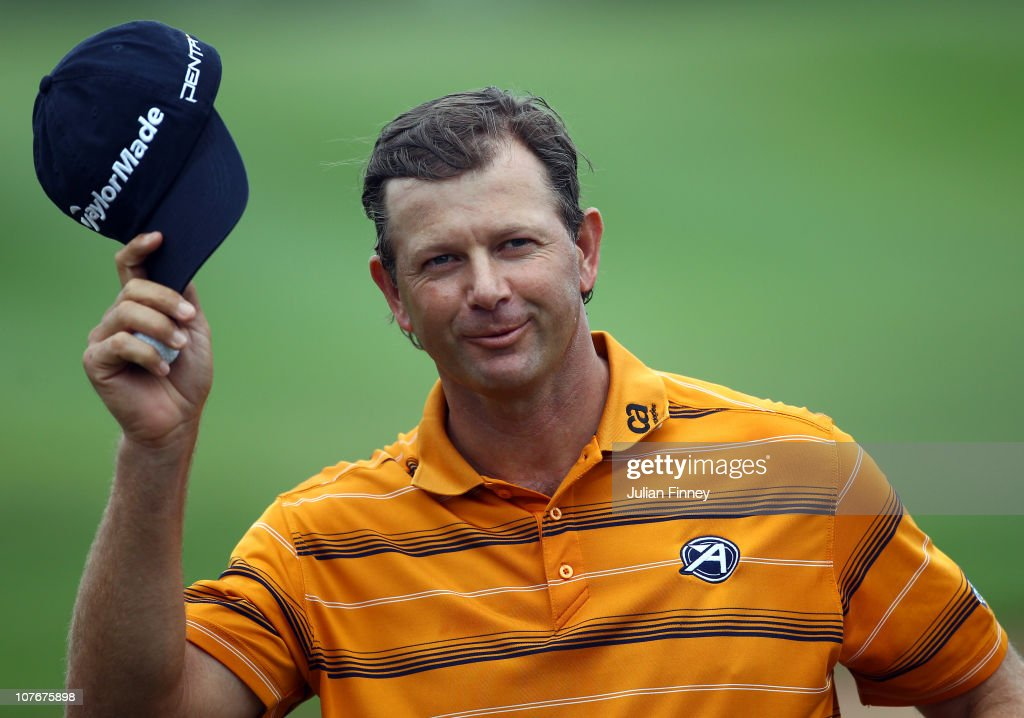 <a gi-track='captionPersonalityLinkClicked' href=/galleries/search?phrase=Retief+Goosen&family=editorial&specificpeople=201918 ng-click='$event.stopPropagation()'>Retief Goosen</a> of South Africa thanks the support after scoring a birdie on the last hole during round two of the South African Open Golf Championship at the Durban Country Club on December 18, 2010 in Durban, South Africa.
