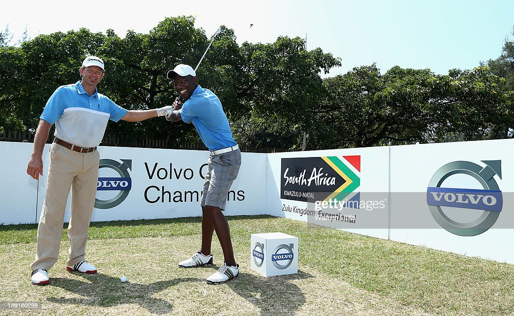<a gi-track='captionPersonalityLinkClicked' href=/galleries/search?phrase=Retief+Goosen&family=editorial&specificpeople=201918 ng-click='$event.stopPropagation()'>Retief Goosen</a> poses with Siyanda Mwandla from Shakaskraal Township as he hosts a development golf clinic for 28 of the South African Golf Development Board's young golfers from KwaMashu, Cato Crest, Umhlali and Mwandla's hometown of Shakaskraal during the Pro-Am for the Volvo Golf Champions at Durban Country Club on January 9, 2013 in Durban, South Africa.