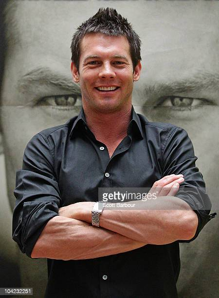 Retired AFL Player Ben Cousins poses in front of a poster of his new DVD 'Such Is Life The Troubled Times Of Ben Cousins' at Westfield Southland on...