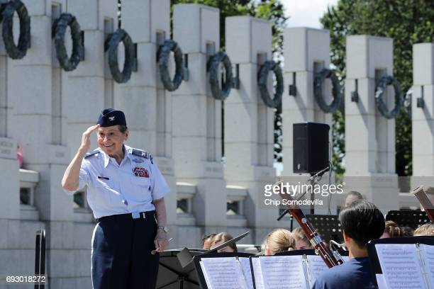 Retired Air Force Colonel Arnald Gabriel conducts the DDay Memorial Wind Band during a ceremony marking the 73rd anniversary of DDay at the World War...