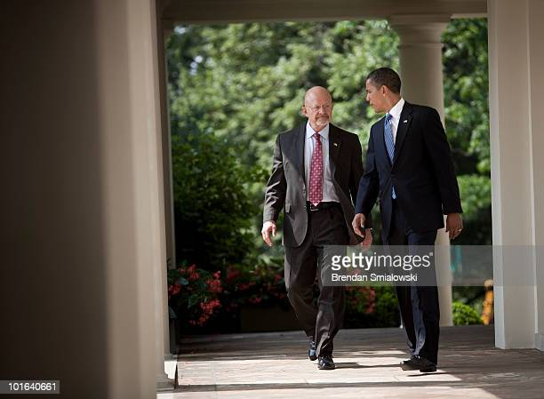 Retired Air Force Lt Gen James R Clapper Jr and President Barack Obama walk to the Rose Garden of the White House June 5 2010 in Washington DC...
