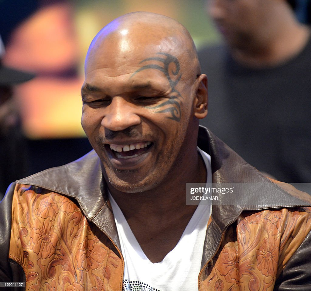 Retired American proffessional boxer Mike Tyson signs autographs at SMS Audio booth at the 2013 International CES at the Las Vegas Convention Center on January 9, 2013 in Las Vegas, Nevada. CES, the world's largest annual consumer technology trade show, runs from January 8-11 and is expected to feature 3,100 exhibitors showing off their latest products and services to about 150,000 attendees.AFP PHOTO / JOE KLAMAR