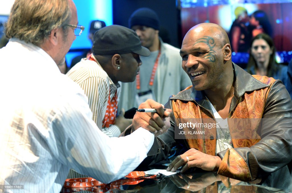 Retired American proffessional boxer Mike Tyson signs autographs at SMS Audio booth at the 2013 International CES at the Las Vegas Convention Center on January 9, 2013 in Las Vegas, Nevada. CES, the world's largest annual consumer technology trade show, runs from January 8-11 and is expected to feature 3,100 exhibitors showing off their latest products and services to about 150,000 attendees.