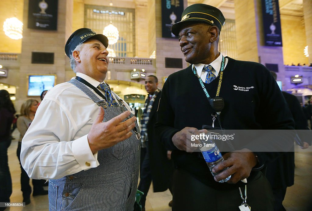Retired Amtrak conductor Tom Savio (L) talks with Metro-North Railroad representative Melvin Johnson in Grand Central Terminal during centennial celebrations on the day the famed Manhattan transit hub turns 100 years old on February 1, 2013 in New York City. The terminal opened in 1913 and is the world's largest terminal covering 49 acres with 33 miles of track. Each day 700,000 people pass through the terminal where Metro-Noth Railroad operates 700 trains per day.