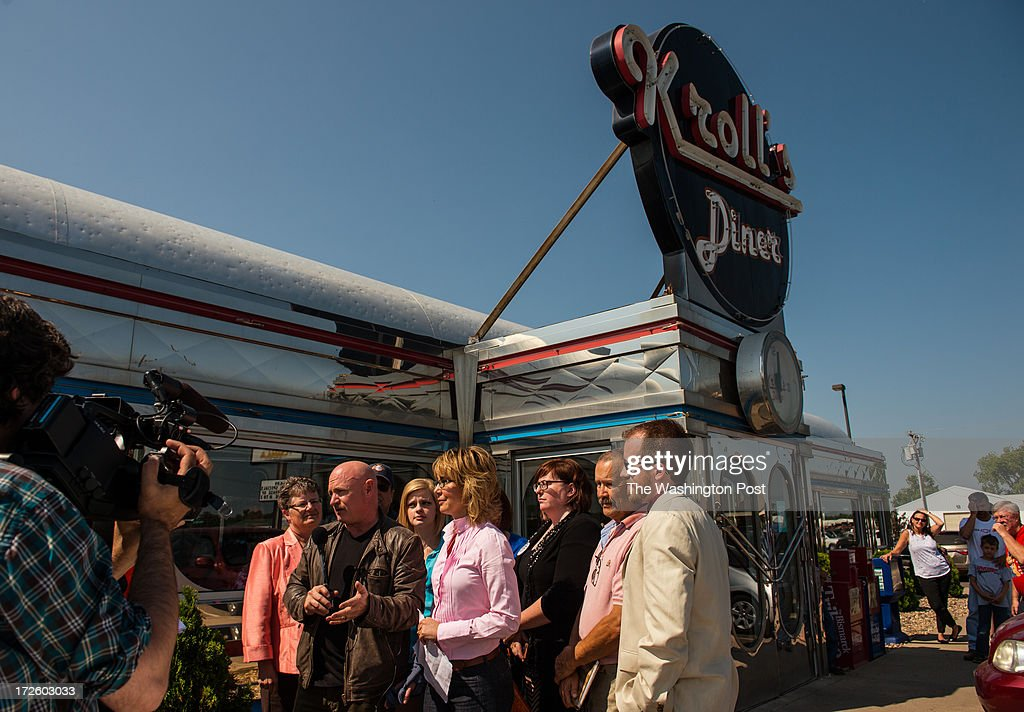 Retired Astronaut Captain Mark Kelly and former Congresswoman Gabrielle Giffords chat with members of the local media during a stop at Kroll's Diner, during the Americans for Responsible Solutions 7 state tour in Bismarck, North Dakota, on Wednesday, July 3, 2013.