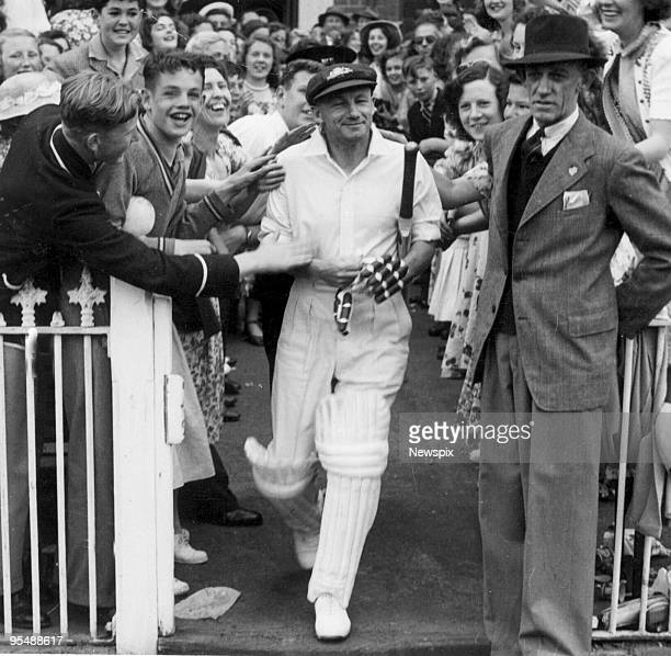 Retired Australian captain Don Bradman makes his way onto the MCG in 1948 for his testimonial match in Melbourne Australia