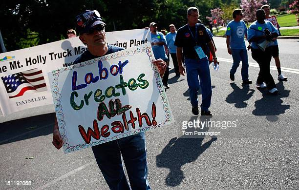 Retired auto worker Roger Heavner participates in the 'Charlotte Labor Day Parade' on September 3 2012 in Charlotte North Carolina Labor groups from...