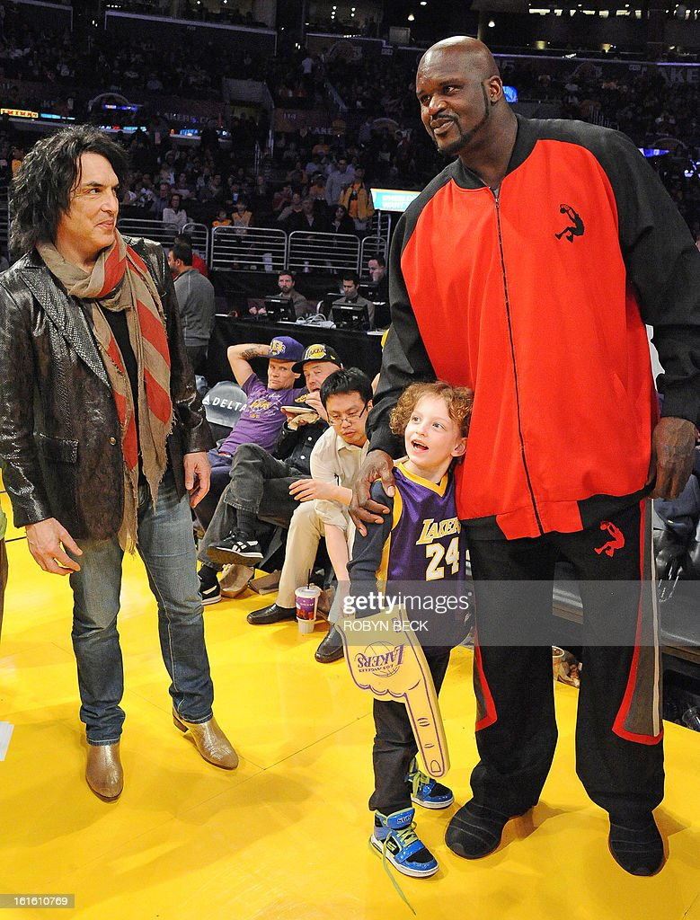 Retired basketball player Shaquille O'Neal (R) greets Colin, the son of Kiss musician Paul Stanley (L) courtside at the Los Angeles Lakers NBA match up against the Phoenix Suns, at Staples Center in Los Angeles, California, February 12, 2013. The Lakers defeated the Suns, 91-85. Kobe Bryant finishes with only four points, nine assists and eight turnovers. AFP PHOTO Robyn BECK
