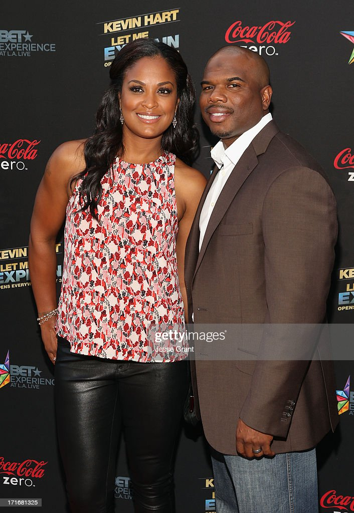 Retired boxer Laila Ali (L) and former NFL player Curtis Conway attend Movie Premiere 'Let Me Explain' with Kevin Hart during the 2013 BET Experience at Regal Cinemas L.A. Live on June 27, 2013 in Los Angeles, California.