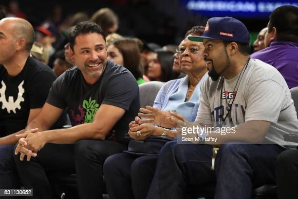 Retired Boxer Oscar De La Hoya sits with recording artist Ice Cube during week eight of the BIG3 three on three basketball league at Staples Center...