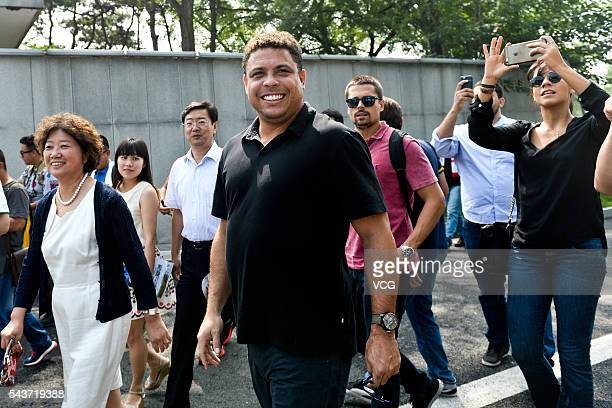 Retired Brazilian footballer Ronaldo Luis Nazario de Lima attends football activity at Beijing 101 Middle School on June 30 2016 in Beijing China...