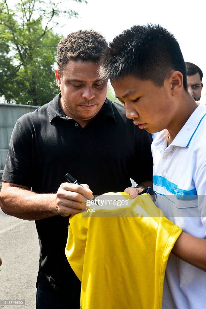 Retired Brazilian footballer Ronaldo Luis Nazario de Lima signs name during the football activity at Beijing 101 Middle School on June 30, 2016 in Beijing, China. Ronaldo participated the football activity at Beijing 101 Middle School and was appointed as the football charity ambassador of China Children and Teenagers' Fund on Thursday.