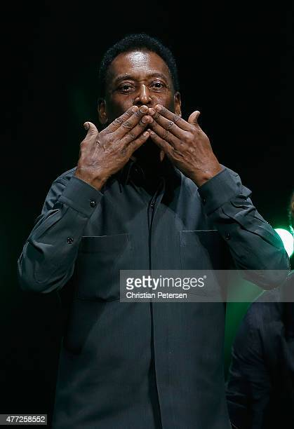 Retired Brazilian professional footballer Pele gestures to fans as he leaves the Electronic Arts E3 press conference at the LA Sports Arena on June...