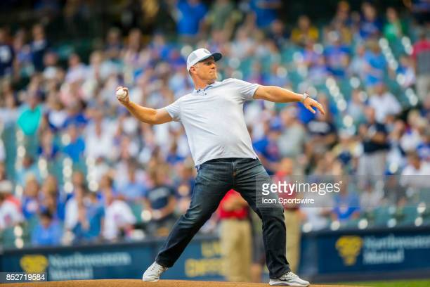 Retired Brewer Geoff Jenkins throws out the first pitch prior to the start of the second game of the final home series between the Milwaukee Brewers...