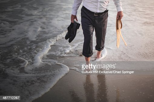 Retired businessman paddling in sea : Stock Photo