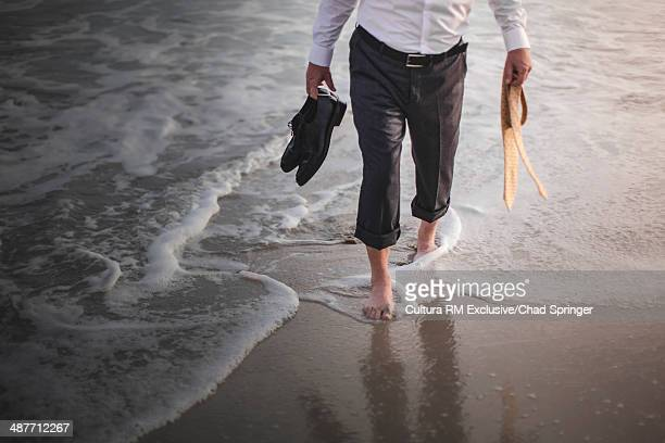 Retired businessman paddling in sea
