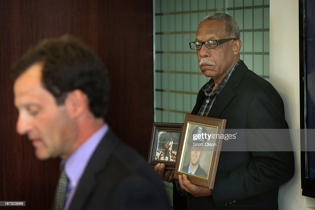 Retired Chicago police officer Thomas Wortham III (R) holds pictures of his son and listens as Jonathan Lowy of the Brady Center to Prevent Gun Violence announces a lawsuit has been filed on behalf of the Wortham family against Ed's Pawn Shop and Salvage Yard in Byhalia, Mississippi during a press conference on April 24, 2013 in Chicago, Illinois. The suit claims that Wortham's son, Chicago Police officer and Iraq War veteran Thomas Wortham IV, was killed by a gun wrongfully sold to a straw purchaser at the pawn shop. Wortham IV was killed outside his parents' home on May 19, 2010 when 4 reported gang members tried to rob him of his motorcycle.