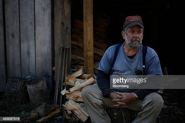 Retired coal miner Jimmy Smith takes a break while chopping firewood across from his home in Totz Kentucky US on Wednesday Nov 6 2013 In 2011 coal...