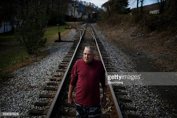 Retired coal miner John Davis stands for a portrait on a CSX Corp railroad spur near his Harlan County home in Totz Kentucky US on Thursday Nov 7...