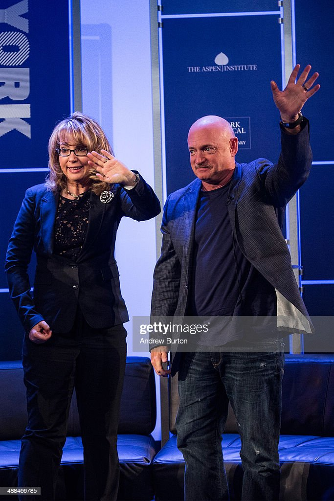 Retired Congresswoman Gabby Giffords (L) and her husband, retired astronaut <a gi-track='captionPersonalityLinkClicked' href=/galleries/search?phrase=Mark+Kelly+-+Astronaut+and+Gun+Control+Advocate&family=editorial&specificpeople=566699 ng-click='$event.stopPropagation()'>Mark Kelly</a>, both co-founders of Americans for Responsible Solutions, wave to the crowd after speaking at New York Ideas, a conference that brings together leaders from a variety of industries on May 6, 2014 in New York City. New York Ideas is hosted by The Atlantic, The Aspen Institute and New-York Historical Society.