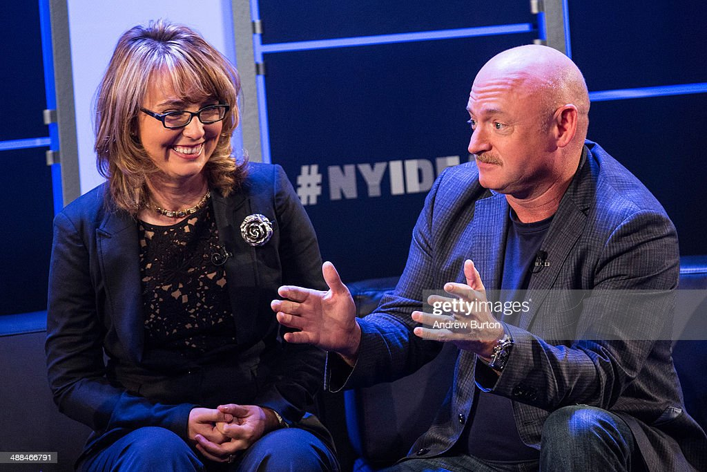 Retired Congresswoman Gabby Giffords (L) and her husband, retired astronaut <a gi-track='captionPersonalityLinkClicked' href=/galleries/search?phrase=Mark+Kelly+-+Astronaut+and+Gun+Control+Advocate&family=editorial&specificpeople=566699 ng-click='$event.stopPropagation()'>Mark Kelly</a>, both co-founders of Americans for Responsible Solutions, speak at New York Ideas, a conference that brings together leaders from a variety of industries on May 6, 2014 in New York City. New York Ideas is hosted by The Atlantic, The Aspen Institute and New-York Historical Society.