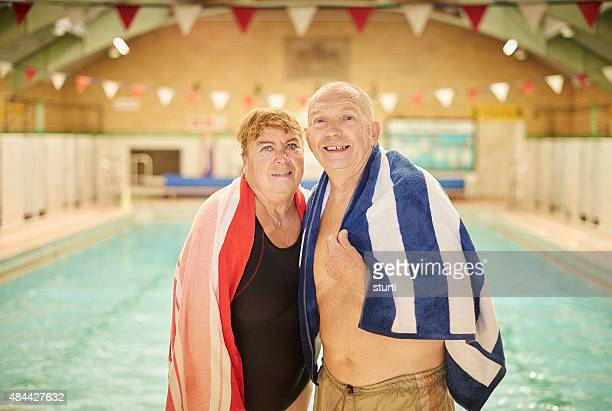 retired couple at the old swimming pool