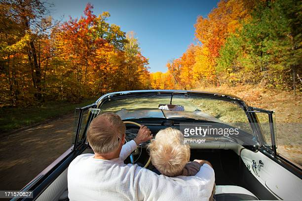 Retired couple enjoying an Autumn drive.